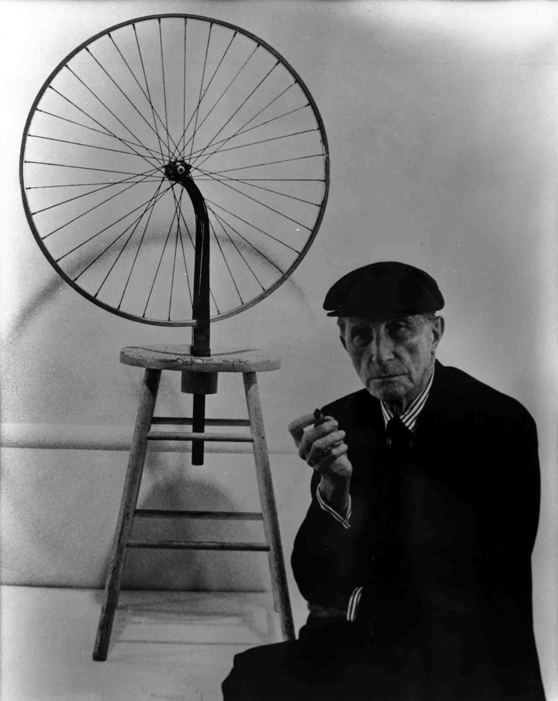 duchamp-with-bicycle-wheel-1913